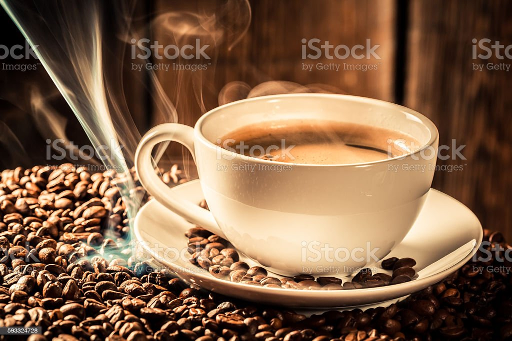 Fragrance coffee cup with roasted seeds stock photo