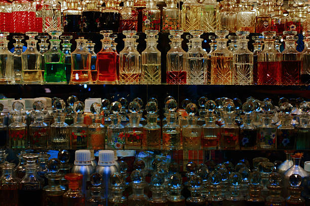 Fragrance in a bottle The sparkling bottles, bright colors and a heavy sweet smelling fragrance drew me to this shop at Charminar, Hyderabad. On display were rows of small decorative bottles with a variety of attar, a natural perfume oil derived from botanical sources, for tourists to buy as souvenirs. The attractive display of the colorful liquids in clear cut bottles under the luminescent lights were absolutely picture perfect. char minar stock pictures, royalty-free photos & images