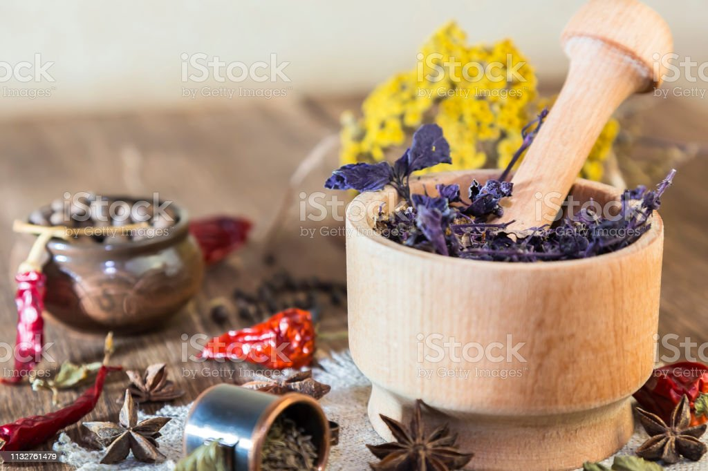 Fragrant dried healing herbs for therapy and spicy spices. On the...