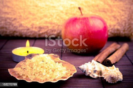 Fragrant salt, apple and cinnamon, candle and towel in the background