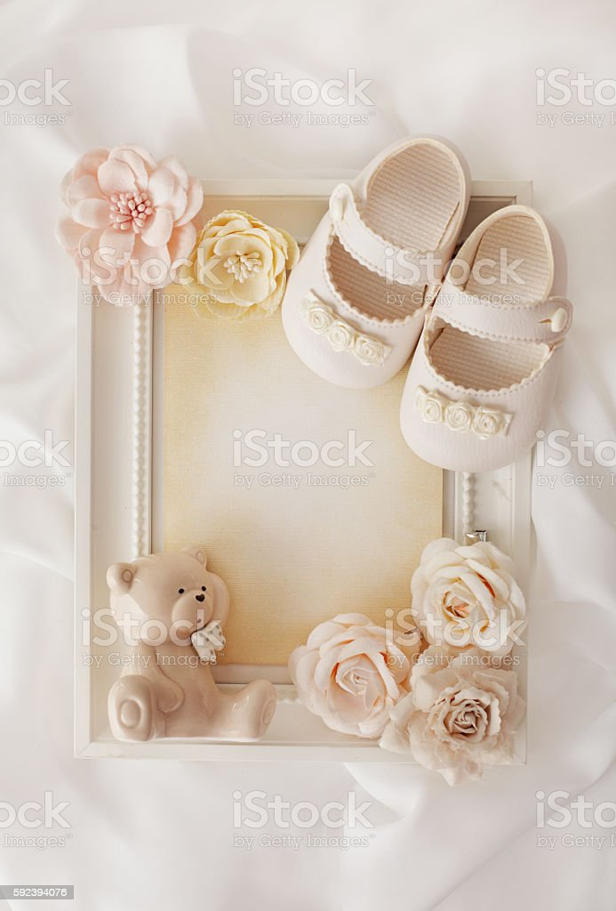 frame background and baby shoes stock photo