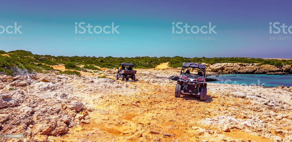 frame cars off-road buggies on sandy roads near the sea
