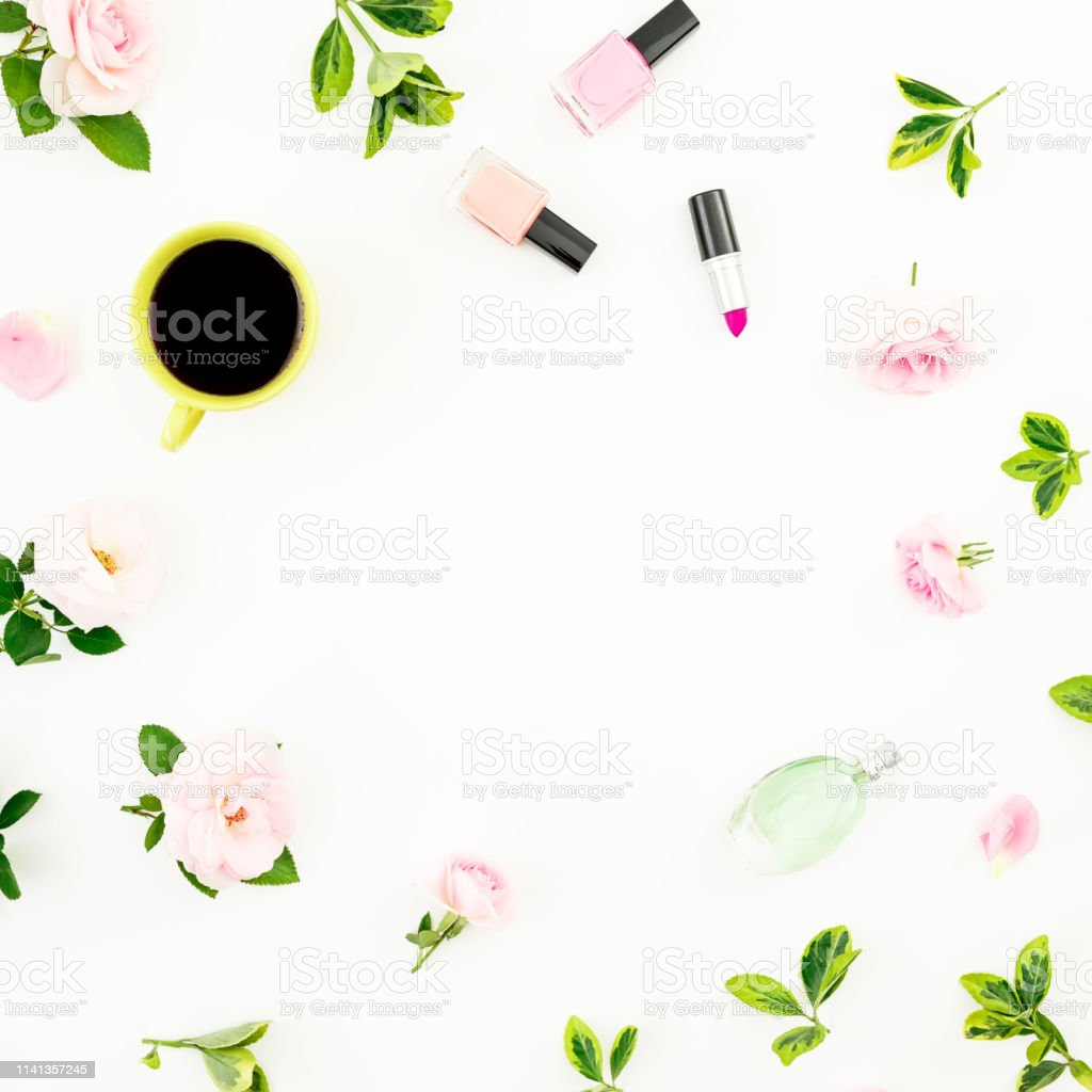 Frame composition with flowers, coffee mug, cosmetics on white...