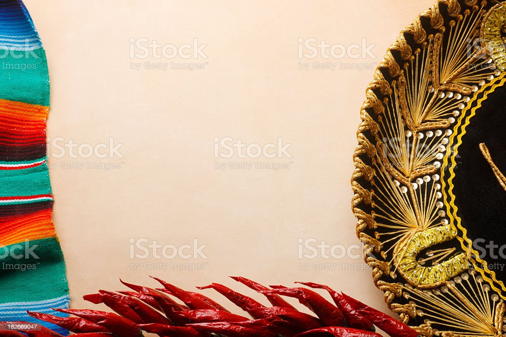 Frame created by a sombrero, chili peppers, and a Mexican blanket royalty-free stock photo