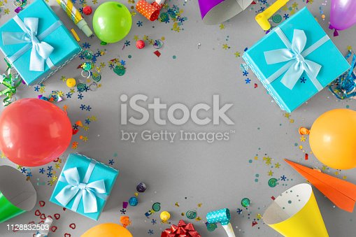 1093222958istockphoto Frame Decoration Party Gray Background Top View Flat Lay 1128832503