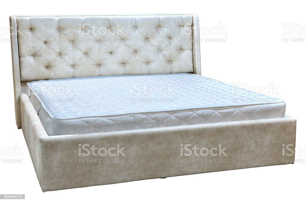 Frame double bed with artificial leather and spring mattress. stock photo