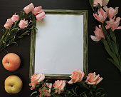 istock Frame for picture with flowers and apples 615997870