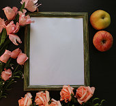 istock Frame for picture with flowers and apples 616000308