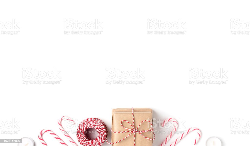 Frame from gift, candles, lollipops, Top view White Background Christmas New Year stock photo