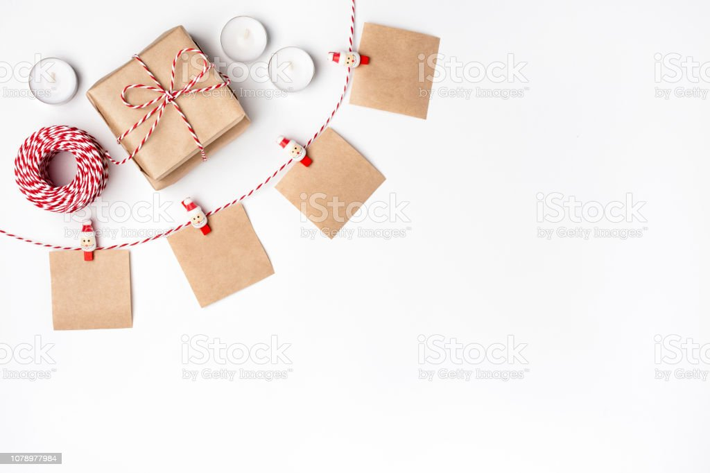 Frame from gift, candles, notes with wish on clothespins, Top view White Background Christmas New Year stock photo