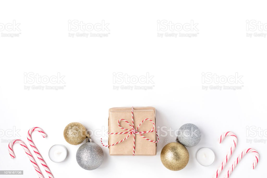 Frame from golden and silver balls, gift, candles, lollipops, Top view White Background Christmas New Year stock photo