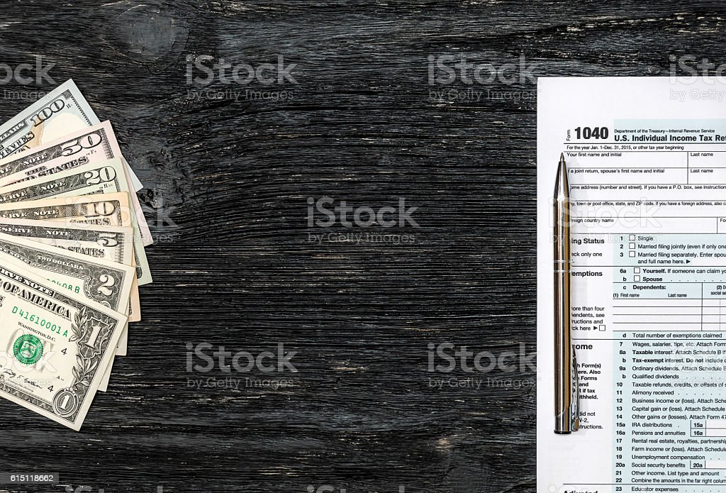 Frame from money and tax form on the wooden background stock photo