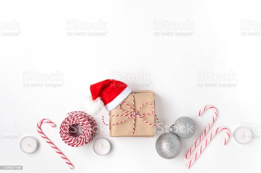 Frame from silver balls, gift, candles, lollipops, Top view White Background Christmas New Year stock photo
