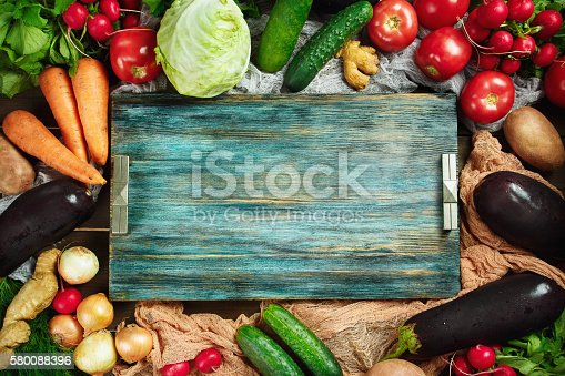 istock Frame made from fresh vegetables on wooden 580088396