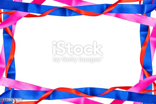 istock Frame made from red, pink and blue satin ribbons isolated on white background with clipping path and copy space in the middle. 1129012873