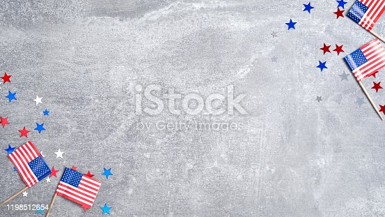 971061452 istock photo Frame made of American flags and confetti stars on concrete stone. Banner template for USA Memorial day, Presidents day, Veterans day, Labor day, or 4th of July celebration. With copy space for text 1198512654