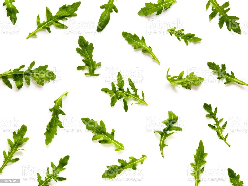 Frame made of arugula leaves on white background stock photo