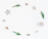 istock Frame made of christmas decoration, cypress branches, pine cones 636423726
