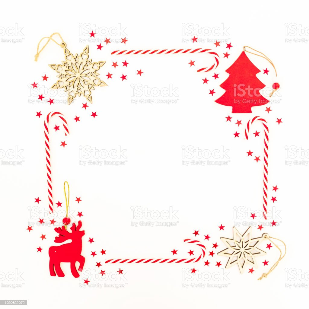 Frame Made Of Christmas Decoration Red Confetti And Candy Cane On