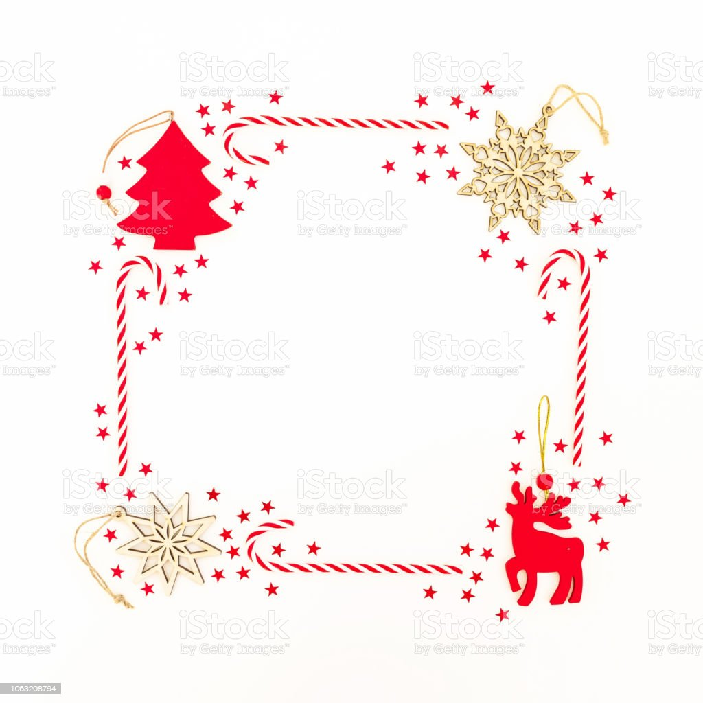 Frame Made Of Christmas Decoration Red Confetti And Candy Canes On