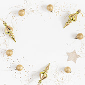 istock Frame made of christmas golden decorations. Top view, flat lay 862045326
