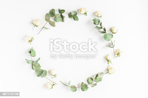 istock Frame made of dried eucalyptus branches and rose flowers 667470746