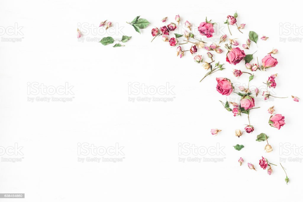 Frame made of dried rose flowers. Flat lay, top view stock photo