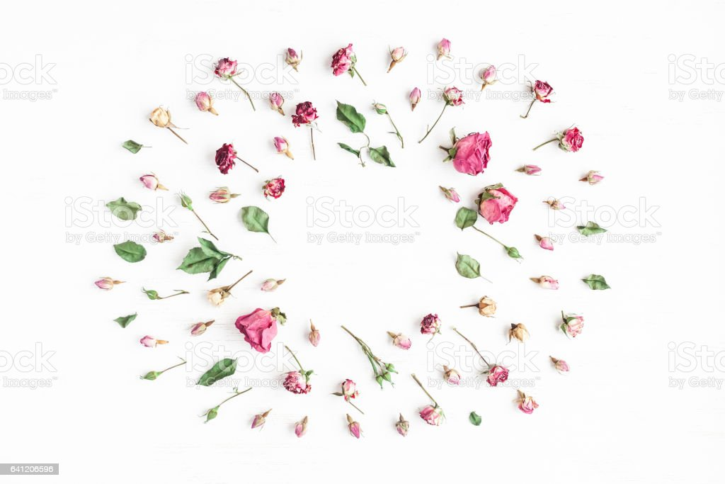 Flowers composition. Frame made of dried rose flowers. Flat lay, top...