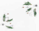 istock Frame made of fir branches, decorations. Flat lay, top view 854343022