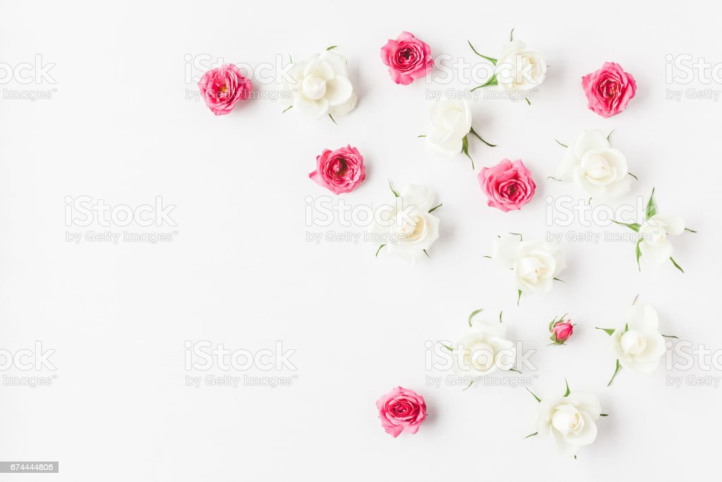 Frame made of fresh rose flowers. Flat lay, top view stock photo