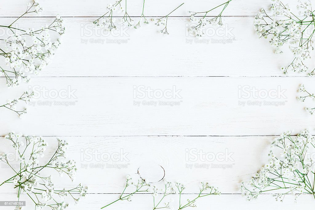 Frame made of gypsophila flowers. Flat lay, top view stock photo