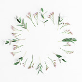istock Frame made of pink flowers and eucalyptus branches 687174272