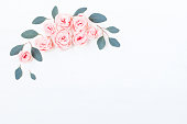 istock Frame made of rose flowers, eucalyptus. Flat lay, top view 808114600