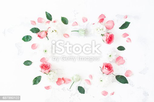 istock Frame made of rose flowers on white background. Flat lay 637350122