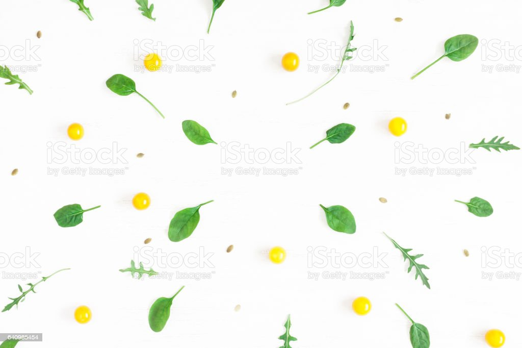 Frame made of yellow tomatoes on white background stock photo