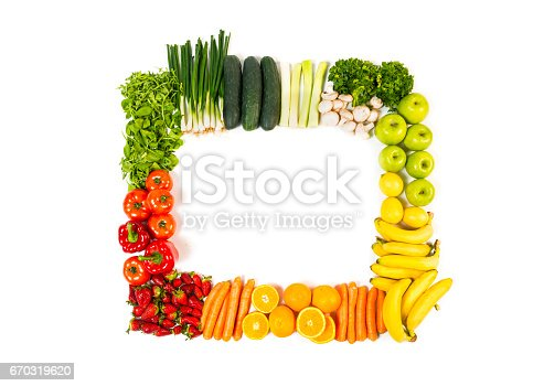 istock Frame made out of fruits and vegetables isolated on white background 670319620