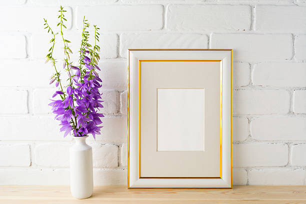 Frame mockup with bluebells bouquet stock photo