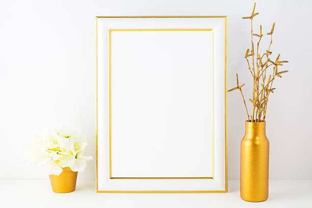 Frame mockup with ivory hydrangea in the golden flower pot stock photo