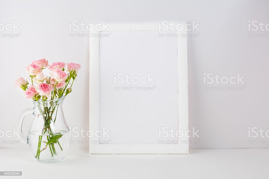 Frame mockup with pink roses stock photo