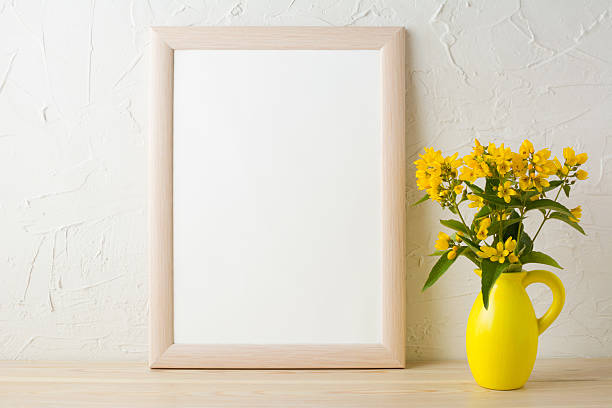 Frame mockup with yellow flowers in stylized pitcher vase stock photo