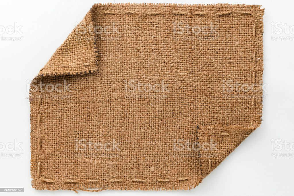 Frame Of Burlap With Curled Edges Lies On A White stock photo | iStock