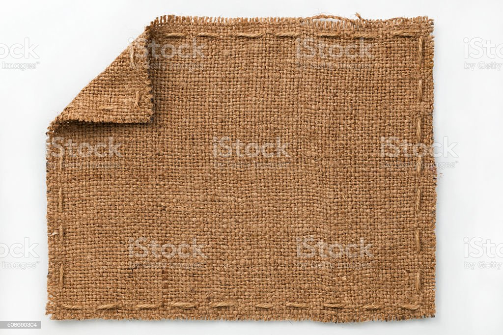 Frame of burlap with curled edges, lies on a white stock photo