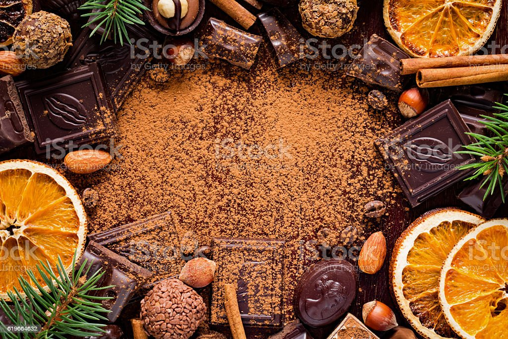 Frame of chocolates, sweets and Christmas decorations stock photo