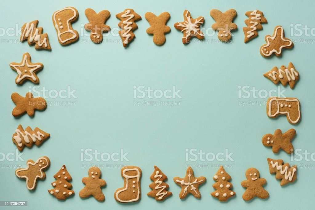 Frame Of Christmas Gingerbread Cookies On Blue Background With Copy