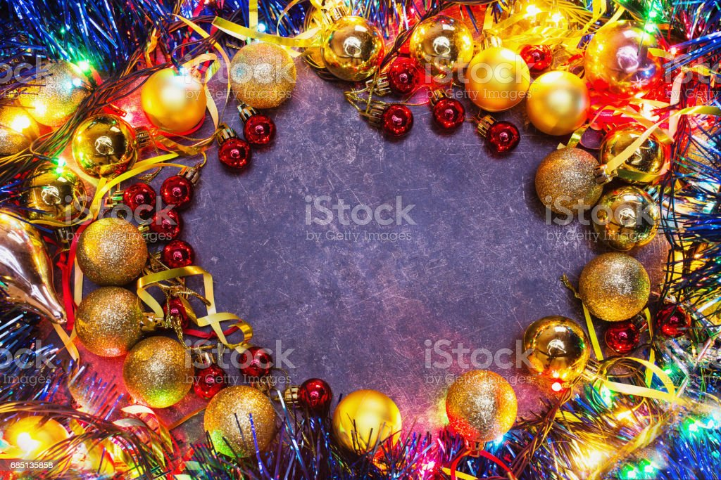 Frame of Christmas toys on table. Celebrate the New Year. Flat lay, top view, copyspace. Garlands royalty-free stock photo