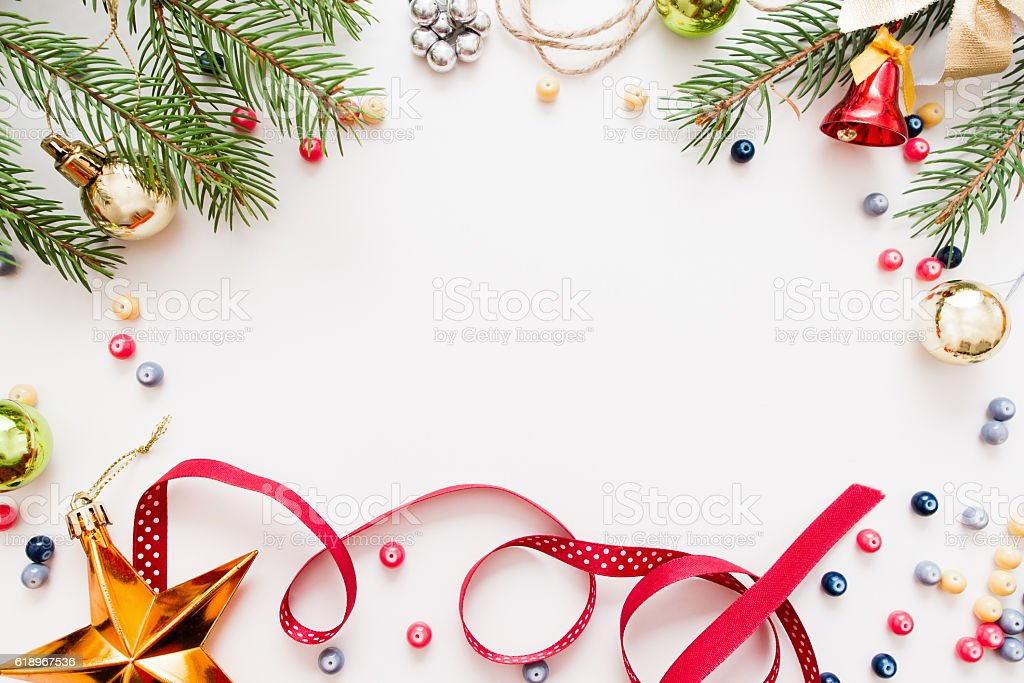 Frame of Christmas tree and trumpery, free space stock photo