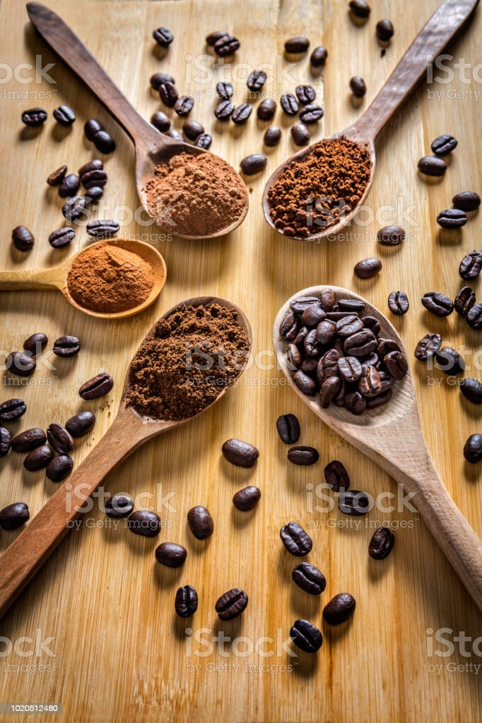Frame of coffee beans roasted, instant and grinded coffee on wooden table stock photo