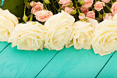 istock Frame of colorful roses. Top view and selective focus 1221830408