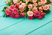 istock Frame of colorful roses. Top view and selective focus 1221830416