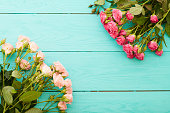 istock Frame of colorful roses. Top view and selective focus 1221830424